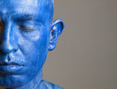 Man and his face painted with color blue (3) — Stock Photo