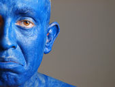 Man with his face painted with color blue (2) — Stock Photo