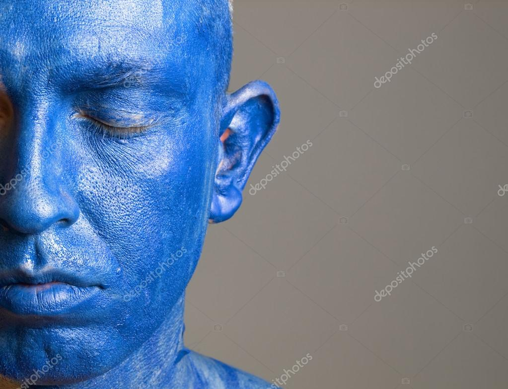 Man and his face painted with color blue. The man is closed eyes and photographic composition leaves only half of the face. — Stock Photo #13212068