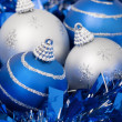 Four Christmas balls on a blue ribbon — Stock Photo