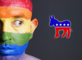 Gay flag face man and the democrat symbol. — Stock Photo