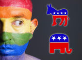 Gay flag face man with the republican and democrat symbol. — Stock Photo