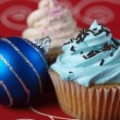 Two cupcakes with christmas balls — Stock Photo