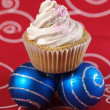 One cupcake and two christmas balls 3 — Stock Photo