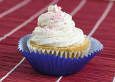 One cupcake with pink balls — Stock Photo
