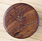 Marijuana symbol woodcarving — Stock Photo