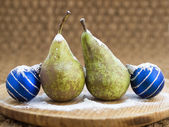 Two pears and two Christmas balls — Stock Photo