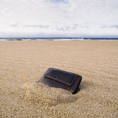 Billfold on the beach over the sand — Stock Photo