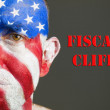 Man face flag of USA, sad expression and Fiscal cliff. — Stock Photo
