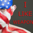 Stock Photo: Mface flag USA, I like weapons, serious expresion