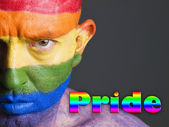Gay flag face man, serious expression and pride concept — Stock Photo