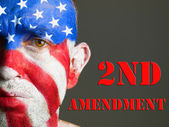 Man face flag USA, 2nd Amendment, sad expression. — Stock Photo