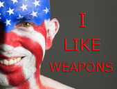 Man face flag USA, I like weapons, smiling expresion — Stock Photo