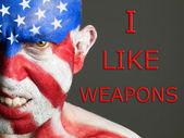 Człowiek twarz flaga usa, jak broń, agresywne wypowiedzi — Zdjęcie stockowe
