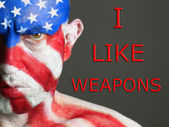Man face flag USA, I like weapons, serious expresion — Stock Photo