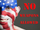 Man face flag USA, no weapons allowed — Stock Photo