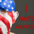 Man face flag USA, I hate weapons, sad expression — Stock Photo