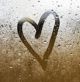Heart painted on glass — Stock Photo