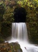 Waterfall in the rock — Stock Photo