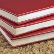Three stacked books - Foto Stock
