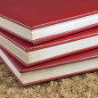 Three stacked books - Stock Photo