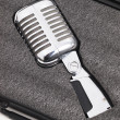 Retro microphone inside a briefcase — Stock Photo