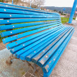 Wooden park bench outdoors - Stock Photo