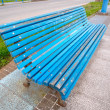 Blue bench in diagonal composition. - Stock Photo