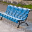 Stock Photo: Blue bench in diagonal composition.