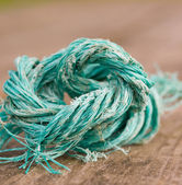 Deteriorated piece of string — Stock Photo