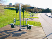 Exercise machines in a park — Stock Photo