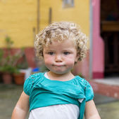 Blonde girl with a funny expression. — Stock Photo