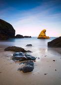 Seascape with an illuminated rock — Stock Photo