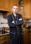 Man in pajamas in his kitchen — Stock Photo