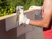 Man spreading tile adhesive — Stock Photo
