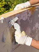 Man spreading tile adhesive, detail. — Stock Photo