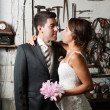 Bride and groom in a garage — Stock Photo