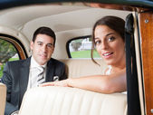 Bride and groom inside a car — Stock Photo