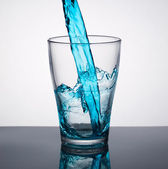 Water pouring into a glass — Stock Photo