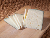 Slices of spanish cheese — Stock Photo