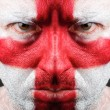 Man with his face painted with the flag of England. — Stock Photo