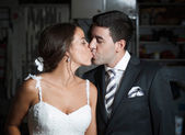 Bridal couple kissing each other — Stock Photo