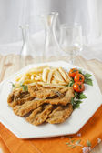 Breaded anchovies with chips — Stock Photo