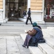 Beggar female — Stock Photo