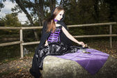 Gothic girl in the wood — Stock Photo