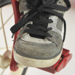 Stock Photo: Foot on Child's Tricycle