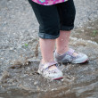 Toddler Legs in Rain Puddle Waves — Stock Photo #47764189