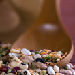 Mix of legumes in a wooden spoon — Stock Photo
