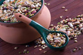Mix of legumes in an earthenware jar — Stock Photo