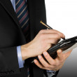 Business-man using a touch-screen device — Stock Photo